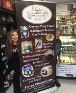 Luisa chocolatiere retractable vinyl banner